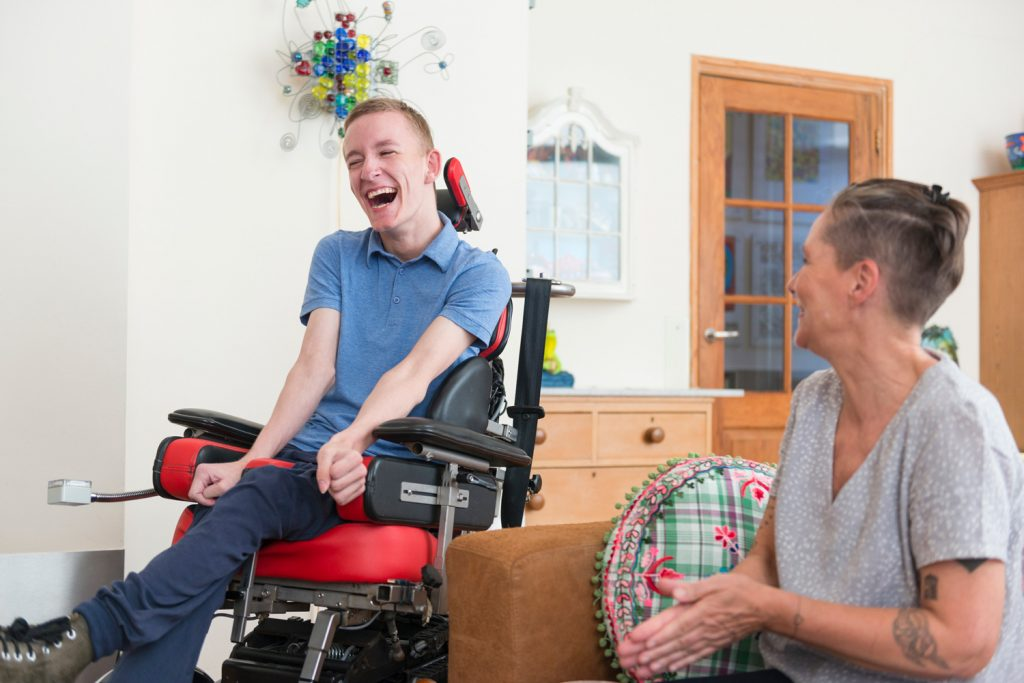 Disabled boy in wheelchair with mother